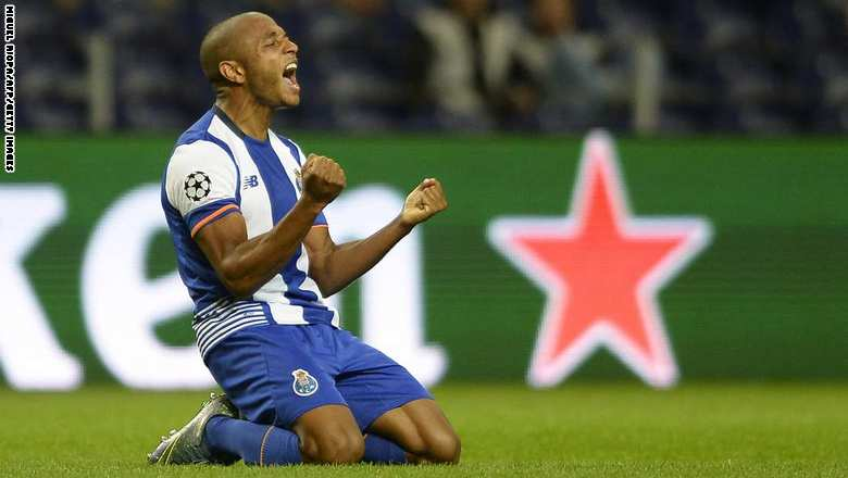 Porto's Algerian midfielder Yacine Brahimi celebrates after scoring a goal during the UEFA Champions League group G football match FC Porto vs Maccabi Tel-Aviv FC at the Dragao stadium in Porto on October 20, 2015.   AFP PHOTO/ MIGUEL RIOPA        (Photo credit should read MIGUEL RIOPA/AFP/Getty Images)