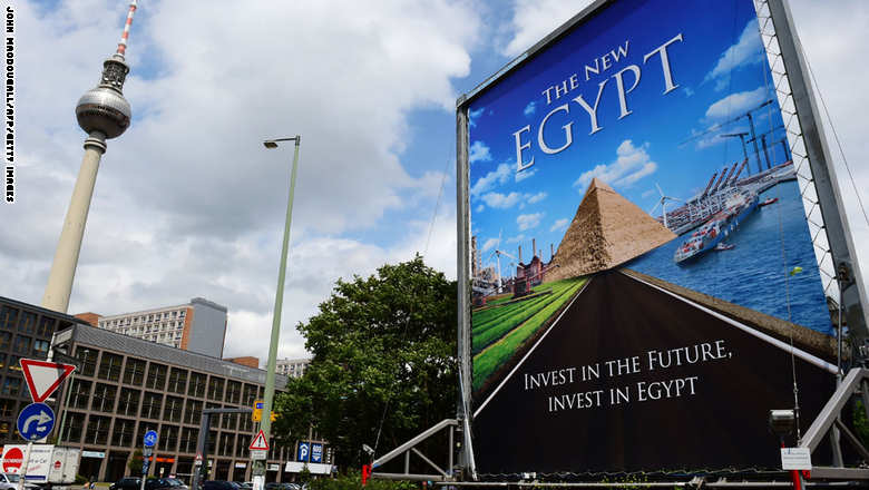Giant mobile billboard promotes investments in Egyptian economy in Berlin, Germany, on June 3, 2015. Egyptian President Abdel Fattah al-Sisi has arrived in Berlin on June 3, 2015, to meet the German heads of state.  AFP PHOTO / JOHN MACDOUGALL        (Photo credit should read JOHN MACDOUGALL/AFP/Getty Images)